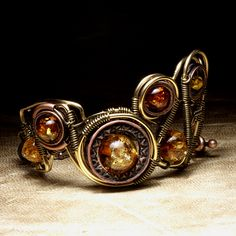 Steampunk Jewelry made by CatherinetteRings - Epic Bracelet with Amber by Catherinette Rings Steampunk, via Flickr