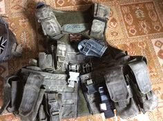 An EXTREMLEY RARE UKSF 22 SAS special forces MSA Paraclete Rav Vest. Combat worn and desert camouflaged used by UKSF task force black operators in Iraq. Modified to include large quick release clips at front in order to prevent sagging during combat.   eBay!