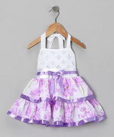 This fun frock brings cheerful color and sweet Southern style to any occasion. Festive features include a twirlable layered skirt, a halter bodice and a dainty bow at the waist.65% cotton / 35% polyesterMachine wash; tumble dryImported