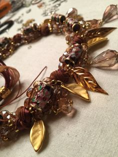 Chocker necklace with crystal drops, ribbons, silk, beads and gold elements. On working ❤️