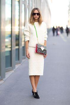 White, oversized costume – knee length, elegant ankle boots, statement handbag. Paris Fashion Week, Street style.
