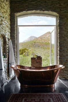 You'll find Bobbejaansberg, a low-slung, wisteria-covered, Karoo slate home and the most perfect hideaway in Barrydale in the Klein Karoo. Copper Tub, South Africa Safari, African Safari, Africa Travel, Beautiful Bathrooms, Lodges, My Dream Home, Future House, Sweet Home