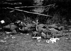 Normandy - Dead German soldiers lie on the ground close to Saint Fromond