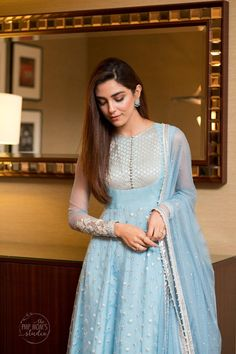 Vivacious yet poised. This flamboyant powder blue pishwas features silver thread work over its awe inspiring flare. It's paired up with a delicately gotta and sequins embellished dupatta. Pakistani Fashion Party Wear, Pakistani Formal Dresses, Indian Gowns Dresses, Pakistani Dress Design, Designer Anarkali Dresses, Designer Party Wear Dresses, Kurti Designs Party Wear, Indian Designer Outfits, Designs For Dresses