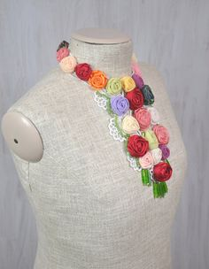 Original necklace with coloured textile roses and glass beads on white lace, metal fastening  Only one of its kind. For unique woman. Romantic and very impressive. Max. necklace width (with the green beads): 8.2 (20.8 cm) Length of the necklace: 15.75 (40 cm)  Made in a smoke free house.  Ready to ship.   Please check dimensions carefully. Due to lighting conditions and monitor settings, colors may appear slightly different, than they are. Items are described to the best of my knowledge. I…