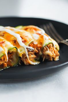 "This Low-carb Chicken Zucchini Enchilada is made with ""zucchini tortillas"" and it's loaded with enchilada sauce, chicken and cheese. It's also gluten-free!"