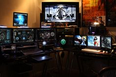 Absolutely one of the best screen setups I have seen for a man cave. Two computers with over 8 monitors.