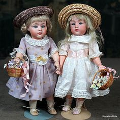 """Heubach Pouty Characters with Glass Eyes as Sisters~ 9.5"""" http://www.dollshopsunited.com/stores/Signaturedolls/items/1291478/Heubach-Pouty-Characters-Glass-Eyes-as-Sisters-95 #dollshopsunited"""