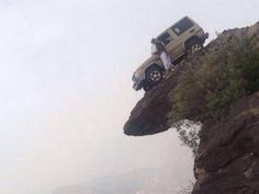 Pictures showing his car being parked on the steep are going viral on the social media . PHOTO COURTESY: KHALEEJ TIMES