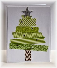 a tree made with washi tape - added a sparkly silver star and some bling.  How easy is that?