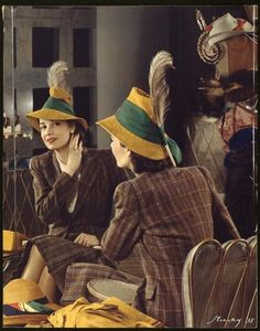 """A young woman in a feathered hat checks her reflection in a large mirror. The image was used on the cover of McCall's magazine, 1938."" #vintage #hat #1930s #fashion"