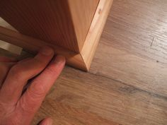How to Install Shoe Molding or Quarter-Round and Cut a Return: Set Second Angled Piece in Place Baseboard Molding, Floor Molding, Moldings And Trim, Baseboards, Crown Moldings, Wainscoting, Vinyl Flooring, Laminate Flooring, Base Shoe Molding