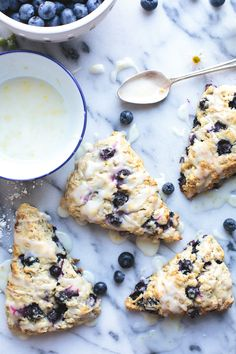 These simple Blueberry Oat Scones, with fiber-rich oats, have a great crumb with bursts of sweet blueberries and a tangy lemon glaze. They make weekend baking so much fun and leftovers are perfect for grab-and-go weekday mornings. Blueberry Lemon Scones, Blueberry Oatmeal, Blueberry Desserts, Vegan Desserts, Good Healthy Recipes, Free Recipes, Top Recipes, Vegetarian Recipes, Healthy Food