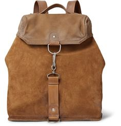 <a href='http://www.mrporter.com/mens/Designers/Maison_Margiela'>Maison Margiela</a>'s backpack combines the label's minimalist aesthetic with functional details, resulting in a style that you'll rely on year after year. Crafted from supple suede, leather and durable canvas, it opens to reveal a capacious interior that can fit your daily kit or in-flight essentials. The distressed finish adds a rugged touch.