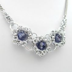 Tanzanite crystal chainmail necklace por TattooedAndChained en Etsy