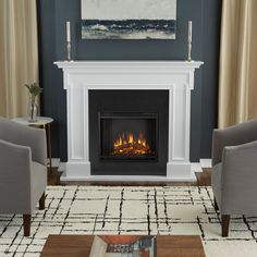 Warm your home with this Thayer electric fireplace. Made with MDF, metal, and solid wood materials, this freestanding fireplace plugs into an outlet, making it a simple and attractive heating solution