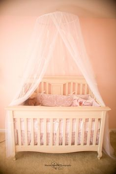 A sweet crib set up with a canopy