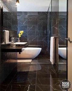 Choose marble-effect black tiles to add depth to a dark bathroom.  #darkbathroom #marblebathroom #bathroomideas #dreambathroom