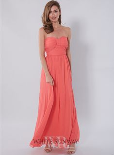 Making History Dress. Beautiful strapless Bridesmaid dress. Features gathering and draping around the bust area with a slightly boned corset. Fully lined. Concealed back zip. Material is a delicate soft chiffon