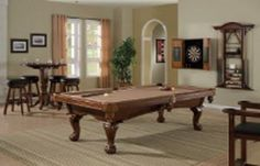 The Riley pool table combines the graceful styling of an arched cabinet and ball & claw legs with a solid hardwood cabinetry, hardwood top rails, blinds and legs.