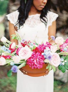 fuchsia floral arrangement - photo by Sarah Beth Photography http://ruffledblog.com/bohemian-aztec-wedding-inspiration