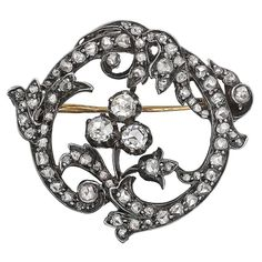 "Mid-19th Century Diamond Foliate Pin. Open circular-shaped foliate motif pin, set with old mine-cut and rose-cut diamonds weighing approximately 2.75 total carats, mounted in silver-topped gold, circa 1850. 1.30"" length (33mm) and 1.18"" width at widest point (30mm)."