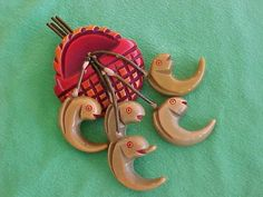 EXTREMELY RARE VINTAGE  BAKELITE FISH IN A BASKET PIN