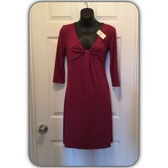 Beautiful Ann Taylor dress Brand new with tags although the tag fell off I still have it. Maroon in color. Jersey like stretchy material Ann Taylor Dresses