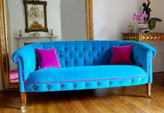 Loving this turquoise sofa….check out the hot pink piping and multi-color button tufting!