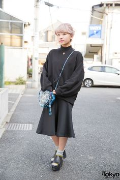 We first street snapped Yuu on the street in Harajuku over three years ago, when she was in high school. In March, she graduated from Bunka Fashion College and she now works as one of the designers for the super-popular boutique Bubbles Harajuku. Here, Yuu is wearing a sweatshirt from Bubbles with a GVGV midi-skirt, a Marc Jacobs heart-shaped bag, and leather Toga platforms.
