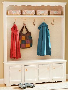 Update an old TV cabinet or china hutch for a new entryway organizer. More makeover ideas: http://www.bhg.com/decorating/decorating-style/flea-market/flea-market-makeovers/?socsrc=bhgpin012514hangyourhat&page=8