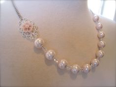 Bridesmaids Jewelry Asymmetrical Wedding Necklace Light Pink Flower Pearls necklace Bridesmaids Necklace Wedding Jewelry whimsical. $29.50, via Etsy.
