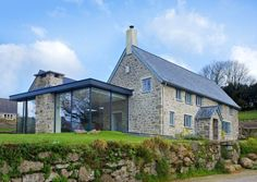 london old stone house exterior farmhouse with etched glass extension Stone Exterior Houses, Old Stone Houses, Wall Exterior, Exterior Remodel, Exterior Design, Farmhouse Renovation, Modern Farmhouse Exterior, Farmhouse Remodel, Style At Home