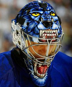 With no hockey season in sight, hockey fans have time to settle some important NHL-related debates. One such debate is which goalie has the best mask. SI counted down the Top 10 goalie masks of the and this gem by Curtis Joseph ranked No. Hockey Helmet, Hockey Goalie, Hockey Teams, Hockey Players, Hockey Stuff, Sports Teams, Goalie Gear, Hockey Baby, Sports Pics