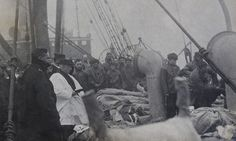 For over 100 years, this photo was hidden in the private collection of the family of a crew member of the ship, Mackay Bennett, which served as a body recovery ship for the sunken Titanic. This photo, taken 9 days after Titanic sank, shows a mass funeral aboard Mackay Bennett for those whose bodies were recovered. The celebrant (draped in white) was Reverend Hind. After the service, the bodies were buried at sea. Body #177 was 28 year old fireman, William Mayo.