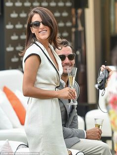 Beaming: The pair seemed to be having a wonderful time as she sipped champagne during the day