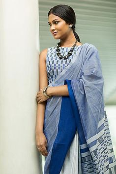 A 100% cotton sari, inspired by the moseic tilework of spanish architecture, of mosques and churches, seen against the mediterranean morning white and pale blue sky.