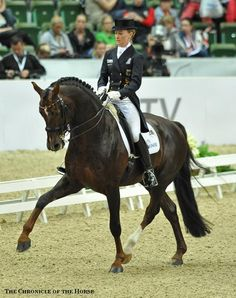 Germany's Helen Langehanenberg and Damon Hill NRW, first place with 88.28, Reem Acra FEI World Cup Dressage final, 2013.