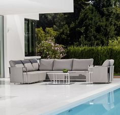 """The Fischer Moebel """"Suite"""" outdoor furniture collection features an architecturally clear design with an urban character. Suite is crafted from high quality stainless steel and weatherproof fabric. The modular construction offers many possible combinations and the useful side tables provide plenty of shelf space."""