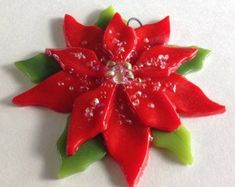 Fused Glass Christmas Ornament (Poinsettia in Red) by CDChilds on Etsy… Fused Glass Ornaments, Fused Glass Jewelry, Fused Glass Art, Glass Christmas Ornaments, Mosaic Glass, Mosaic Mirrors, Snowman Ornaments, Mosaic Wall, Glass Christmas Decorations