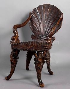 Carved wood Italian grotto chair Hand-carved wood nautical chair, shell-carved back and seat, stylized fish-form arms.