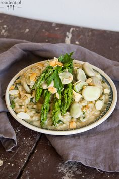 Asparagus risotto with fava beans and silvered almonds