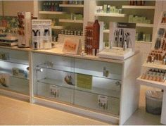 Beautiful perfume cabinets #glasscounters with glass sliding doors and interior glass shelves- glass units are finished in a quality high gloss white - manufactured in the UK to a high standard and supplied by Shopfitting Supplies Ltd.