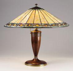 An American Art Glass Lamp. The Handel Company, New York, New York.Circa 1920. Leaded glass, wood, patinated metal.