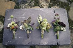 Sweet buttonhole 'bouts.  Textural buttonholes by Pyrus, image by nicrue.co.uk
