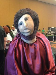Horrifying costume - A very hairy monkey in an ill-fitting tunic! lol