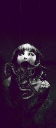 I can't tell which part of this image is most disturbing. The strings, her eyes, or the tentacles.