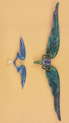 Child & Child - An Art Nouveau gold, silver, enamel and sapphire brooch, circa 1900. Signed. This extraordinary jewel and the smaller verson are based on the Egyptian prophylactic symbol known as the 'winged globe'. This particular example is remarkable in that the wings are hinged and can be pitched at any angle to suit the owner's mood. Source: Charlotte Gere and Geoffrey C. Munn - Artists' Jewellery - Pre-Raphaelite to Arts and Crafts.