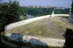 In the swimming pool with a view of the Berlin Wall