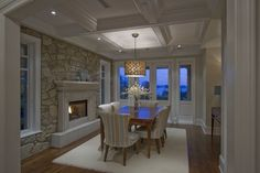 Love ceiling, wall, & fireplace for dinning